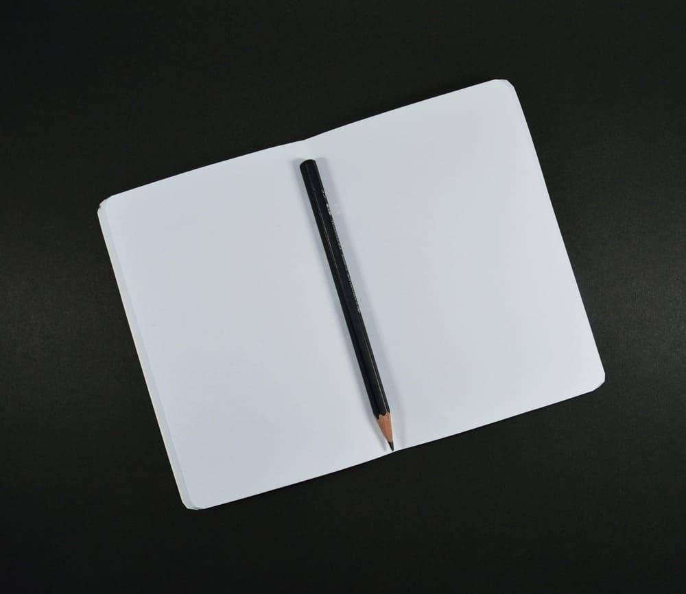 Image d'un crayon posé sur un papier